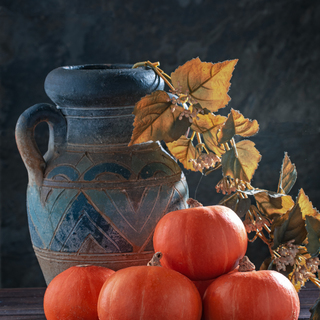 Still life with pumpkins and  jug. Toned.Colors of autumn.