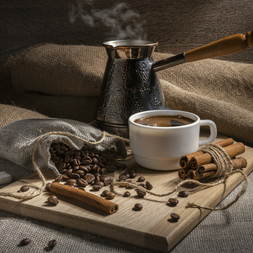 White cup of natural black coffee with cinnamon and a piece of sugar / Кофейная рапсодия