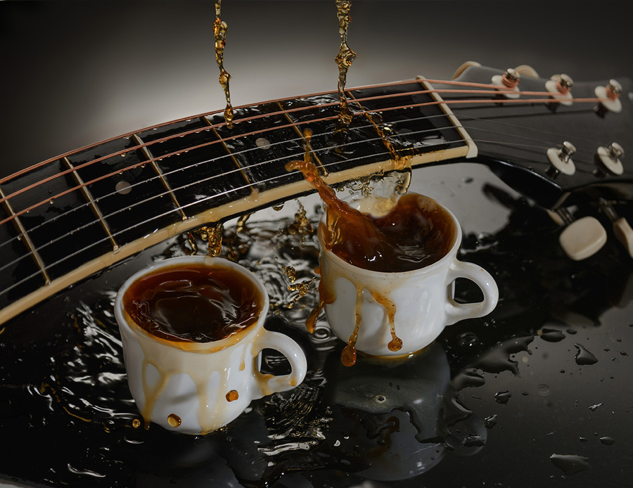 Concept acoustic guitar and two cups of coffee.