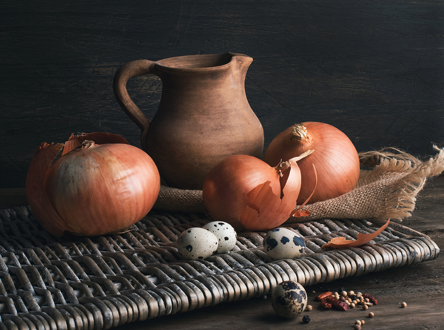 Still life with onions, quail eggs and clay jug